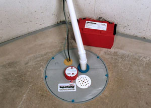 A sump pump system with a battery backup system installed in Kelfield