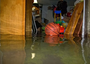 A flooded basement bedroom in Lanigan