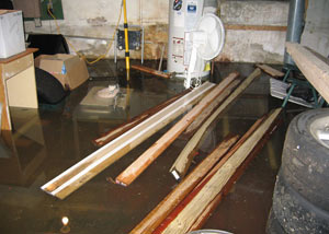 A severely flooding basement in Humboldt, with lumber and personal items floating in a foot of water