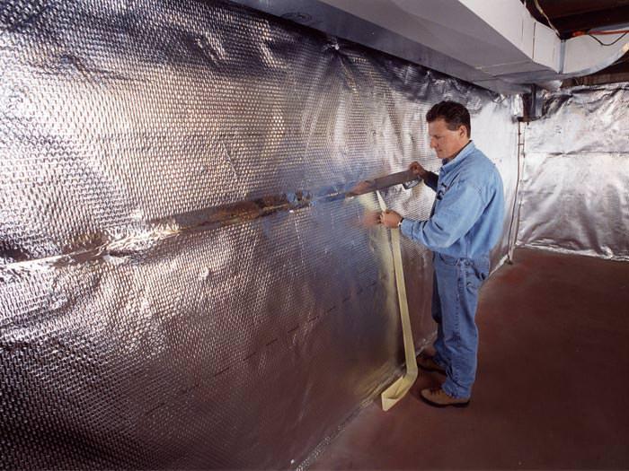 heat and vapor barrier on a basement wall in st isidore de bellevue