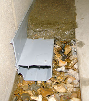 A basement drain system installed in a Meadow Lake home