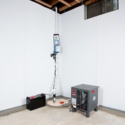 Sump pump system, dehumidifier, and basement wall panels installed during a sump pump installation in Carlton